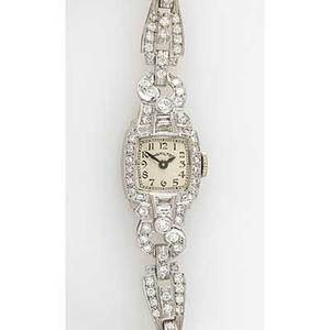 Hamilton diamond and platinum dress watch black arabic numerals and hands on cream face with rope strap 1941 17jewel movement model 911 circular and baguette cut diamonds approx 150 cts tw