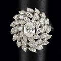 Diamond platinum cocktail ring ca 1960 oval bombe centers oval cut diamond approx 75 ct and three tiers of marquise cut diamonds approx 2 cts tw 143 gs size 9 12