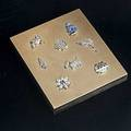 Cartier gold cigarette case diamond platinum charms c 1945 ribbed 14k gold case the lid set with 8 platinum and diamond charms a stork in a hat bunny in blue enameled dress tuttifrutti fruit b