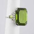 Art deco peridot diamond platinum ring emerald cut peridot 359 cts to baguette cut peridot and halfmoon diamond cluster shoulders 16 gs size 6 14
