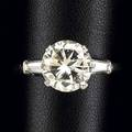 Diamond and platinum solitaire ring round brilliant cut diamond 335 cts by formula flanked by tapered baguette cut diamonds 40 ct tw size 8 12