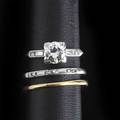 Diamond platinum wedding set and gold guard ring transitional cut principal diamond approx 75 ct baguette and circular cut diamond shoulders companion band 14k guard with diamond melee sizes 2