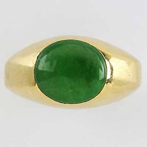 Jean schlumberger for tiffany  co jade 18k gold ring oval jade cabochon 1274mm x 115mm in gypsy setting marked tiffany schlumberger 123 gs size 10 gem has not been tested for evidence of in