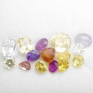 Fifteen unmounted fancy sapphires cabochon star sapphire and fourteen mixed cut faceted gems colors include magenta orange yellow pink salmon pale blue and colorless 537 cts tw note unmount