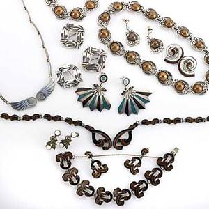 Margot of taxco silver jewelry eighteen pieces many with enamel volutelink suite with black and brown enamel scrollsuite with copper halfbeads coil ear clips with white and brown enamel confro