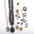 Collection of antique jewelry tortoiseshell locket and chain ca 1870 gold and woven hair crucifix brooch ca 1870 meissen porcelain and silver pendant arts  crafts silver moonstone and blister