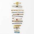 Fourteen gold bar pins many set with seed pearls or sapphires diamonds spinel or enamel ca 1900 508 gs longest 2 12