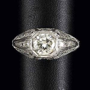 Art deco diamond and platinum ring principal round brilliant cut diamond approx 80 ct diamond melee and palmette chased ornaments ca 1920 42gs size 6