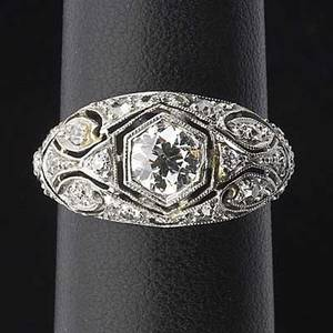 Art deco diamond and platinum ring octagonal set oec cut diamond approx 45 ct and diamond melee in pierced tapered mount millegrain details throughout mark jw 18979 36 gs size 5