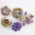 Five art nouveau enameled gold flower brooches each set with diamonds or pearls 14k yg unmarked 299 gs largest 1 58