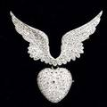 Tiffany  co diamond mercury wing brooch ca 1900 paired wings suspend heartshaped pendant fitted with removable brooch armature approx 480 cts tw diamonds in platinumtopped gold winged elem