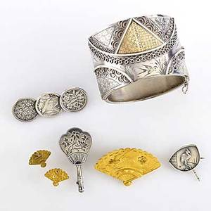 Japanesque gold and silver jewelry seven pieces 18801900 broad cuff with inlaid gold chester 1882 14k fan motif brooch with glazed obverse and matching earrings two silver fan brooches silver
