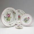 Keller  guerin luneville france fiftyfour piece mixed faience set includes fourteen dinner plates ten luncheon plates five soup bowls twelve reticulated cake plates covered tureen gravy boa