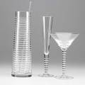 Dante marioni steuben banded evening suite includes cocktail pitcher with sterling silver stirrer nine martini glasses and six champagne glasses ca 2004 with original bags and boxes tallest 11