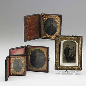Civil war union images seven items include daguerreotype of a soldier portrait of a soldier tintype of a boy in military dress next to a seated african american man tintype of a soldier etc lar