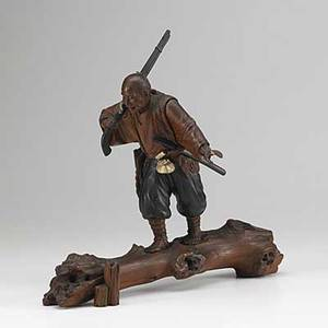 Japanese wood and ivory carving samurai with rifle and sword mounted on a wood stump late 19th c 16 14 x 16