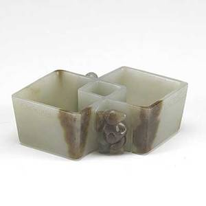 Off white and russet jade washer carved with a bear on one side and a small boy on the other 19th c 4 18