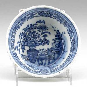 Blue and white export bowl underglaze blue with flowers bat and auspicious symbols and foliate design along rim 18th c 5 18 dia