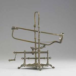 Mechanical wine cradle victorian brass with floral design on four claw feet 19th c 10 14 x 11 14 x 7 14