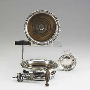 Wine accessories five pieces 19th20th c silver plate wine bottle coasters with art nouveau applied border corkscrew with stag and ivorybone handle columbus springloaded corkscrew and silver t