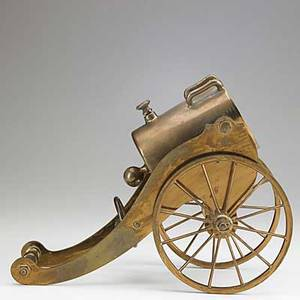 Mechanical wine cradle brass in the form of a cannon 19th20th c 12 12 x 9 12 x 6