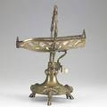 Mechanical wine cradle french renaissance revival base terminating on three centaur feet 19th c marked liezard pere  fils 10 x 14 x 6 12