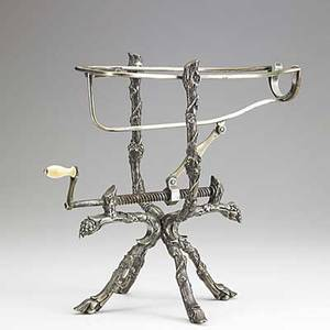 Mechanical wine cradle silver plate the base a grapevine with wire cradle and ivory handle 19th c 12 12 x 10 12 x 7 12