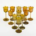 Tiffany studios eleven gold favrile glass cordial glasses new york 1920s all signed lct two with numbers each 5 14 x 2