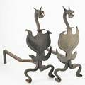 Wrought iron andirons dogs heads above a shield early 20th c 26 x 11 x 28