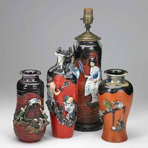 Japanese sumida gawa pottery four vases with applied decoration one mounted as a lamp late 19thearly 20th c tallest 12 without mounting