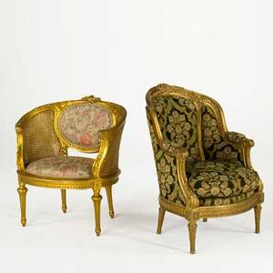Two louis xvi style armchairs both with gilded frames and floral upholstery 20th c larger 39 x 26 x 28