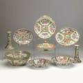 Chinese rose medallion group nine items 19th20th c pair of candlesticks covered entree dish three bowls and three platters largest 10 14 x 4 34