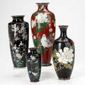 Japanese cloisonne vases four early 20th c three with floral displays on black ground and one with birds on red ground tallest 12