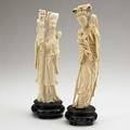 Asian ivory figures a man and a woman with flowers 19th20th c taller 10