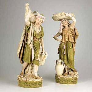 Royal dux porcelain figures of a male and female water carrier 20th c marked taller 28