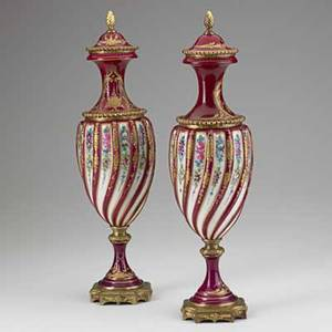 Pair of french porcelain urns handpainted floral decoration with dore bronze mounts 19th20th c marked france 15 12 x 4