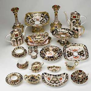 Royal crown derby fortynine pieces of imari and old imari porcelain 20th c includes pair of candlesticks center bowl tall teapot and coffee pot low teapot and coffee pot 6 footed teacups an