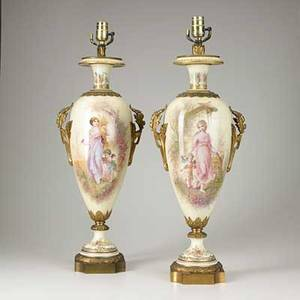 Sevres pair of handpainted porcelain urns with cherubs and bronze mounts mounted as lamps early 20th c marked artist signed m demonceaux 27 14
