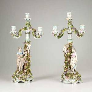 German porcelain pair of 3arm porcelain candelabra with cherub picking flowers for a young woman late 19thearly 20th c marked schierholz 20 12 x 9 12