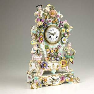Meissen shelf clock with seated figures and applied floral decoration french time and strike movement 19th c crossed swords mark 15 x 9 x 6