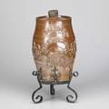 English stoneware ice water cooler two gallon jug decorated with grapevines knights lions and the coat of arms of the british monarchy 19th c complete with spigot 13 x 8 14 dia