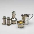 Sterling by tiffany  co 19021990 gadroon footed salt cellar with gilt interior and pepper shaker with floral band 19021907 two pepper shakers with wave edge 19071947 elsa peretti padova bab