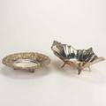 Two turkish footed silver bowls 20th century oblong fruit bowl by polisan with roquille ornaments 16 round shallow bowl with floral repousse border and gilt highlights 10 both 900 silver 309