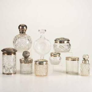 Lalique perfume bottle and vanity accessories eight silver mounted cut glass jars and bottle ca 1900 tallest 6 damages lalique france colorless perfume bottle depicts wild rose 6 12