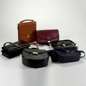Eight leather designer daybags 19701990 unisex lancel paris textured rust folio with detachable strap 9 12 x 7 34 and bordeaux shoulder bag 6 x 10 unisex longchamp paris dark brown cl