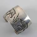 Silver overlay cuff by manuel hoyungwa hopi broad open cuff with stalking bears and stylized foliage retailed by kopavi shop 38 ot 1 78