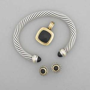 David yurman silver and gold onyx cable jewelry cushionshaped enhancer pendant 1 14 circular stud earrings trimmed in 18k yg 12 open cuff with 14k yg accents all in original pouches 637