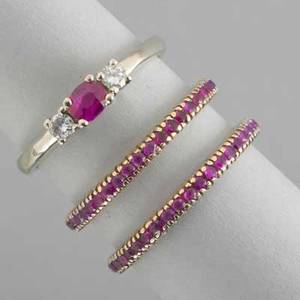 Three rings with rubies and diamonds threestone central ruby with two diamonds approx 16 ct tw in 14k wg pair of ruby eternity bands in rose gold 43 dwt gw 67 gs gw sizes 8  8 12