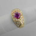 Ruby and diamond 14k ring circular faceted ruby approx 15 cts and diamond pave approx 75 ct 53 dwt 82 gs size 9 12 note this lot is being sold to benefit manna