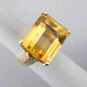 Large citrine 14k yellow gold ring ca 1965 laterally set step cut citrine approx 32 cts in textured yellow gold 125 dwt 194 gs size 9